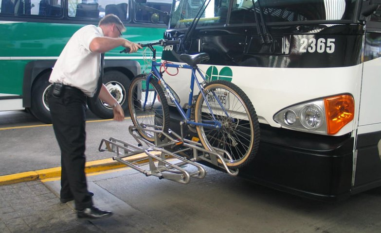 GO Bus driver mounting bike on GO Bus bike rack