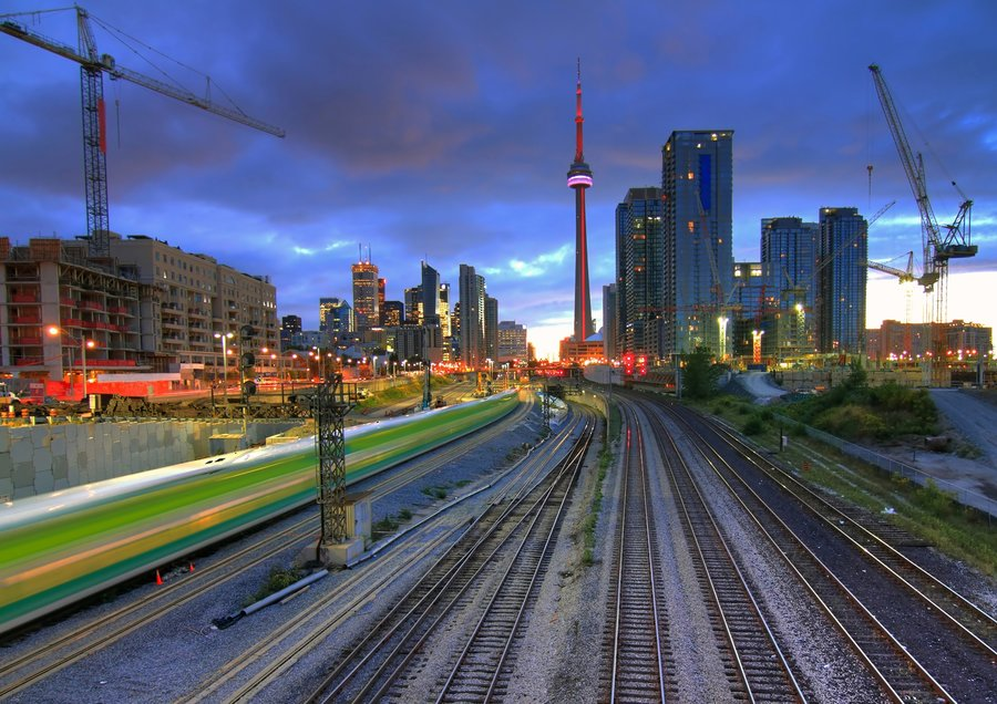 GO Train in motion with CN Tower in background