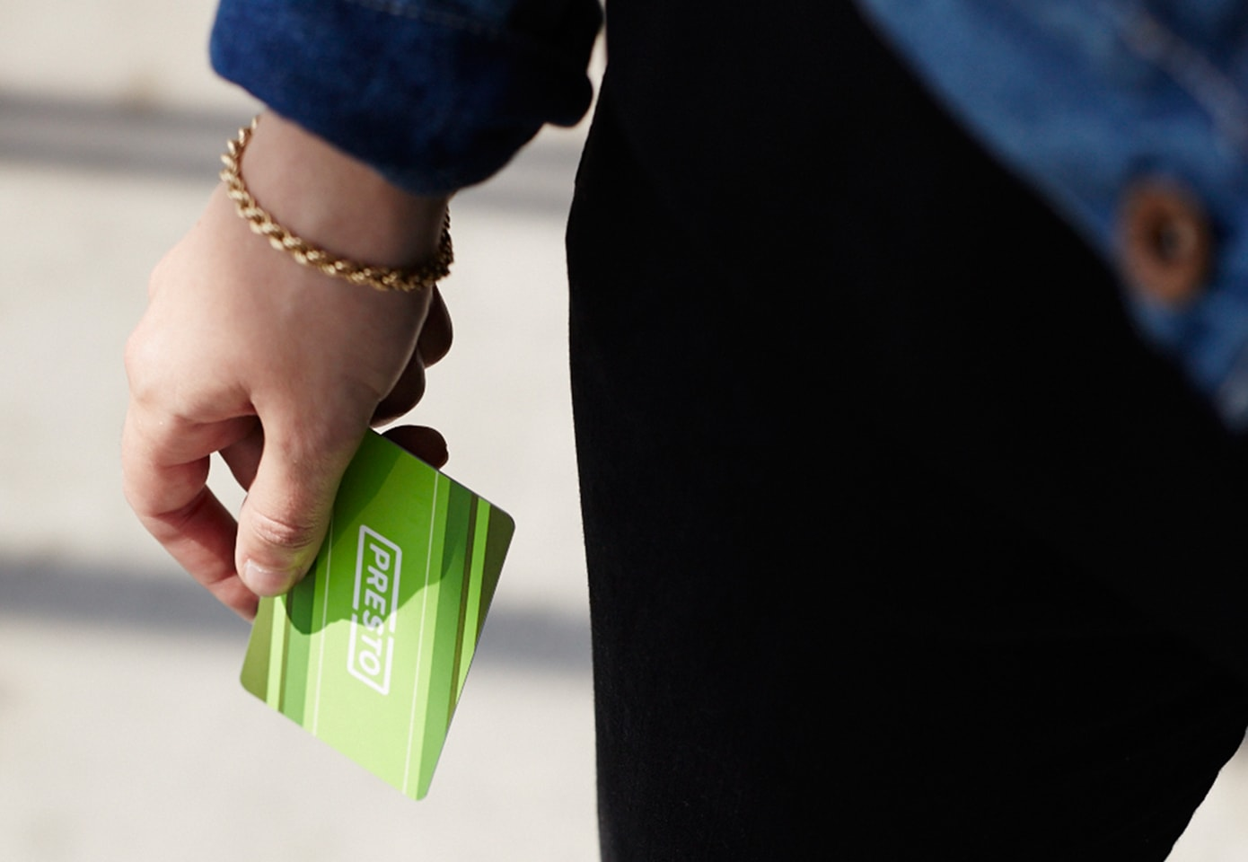 Customer holding a PRESTO card