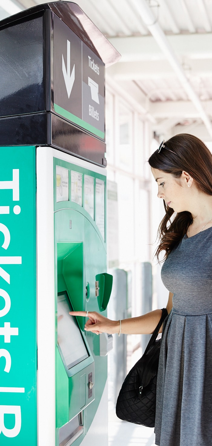 Customer using GO transit automated ticket vending machine